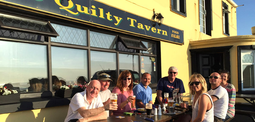 Apres dive pints outside the Quilty Tavern