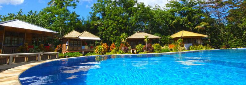 Chalets around the swimming pool at Two Fish resort Bunaken